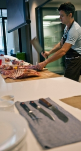 """Knife in hand Adam Danforth leads a two-hour seminar """"Watching the science of meat flavor: goat butchery and reverence for older animals"""" at the Sterling-Rice Group in Boulder on Sept. 29. 2014."""