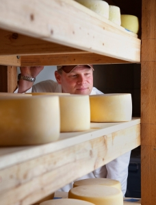 Owner Alex Seidel in the cheese aging room at Fruition Farms in Larkspur, Colorado. Photo by Kevin J. Miyazaki/PLATE