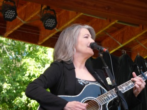 "Kathy Mattea performed her first hit ""She Came From Fort Worth"" with the line ""She's got a one-way ticket on the next bus for Boulder."""